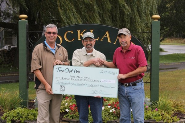 Keenan Flanagan, pro at Rockland Golf Club (left), and Time Out Pub Owner Jim Beaulieu (right) present $1,550 proceeds check to PMHSKC Board President Richard Procopio (center) from the September 15 Time Out Pub Golf Tournament