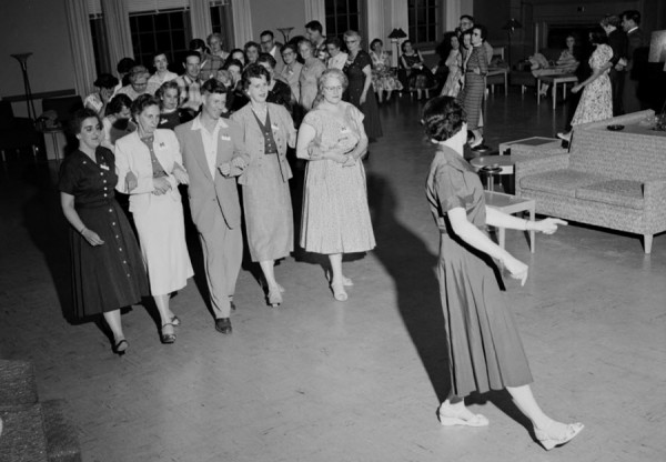 Eileen Cassidy, right foreground, associate professor of physical education at the University of Maine, leads summer-school enrolees in &quotget-acquainted&quot games during registration at the university on Monday, July 9, 1956.