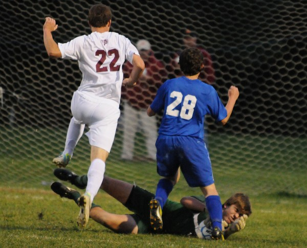 Bangor's Sam Huston (left) and Lawrence's Parker Towne avoid a collision with Bangor goalkeeper Stanley Clarke during first-half action on Tuesday night. Bangor won 5-0.
