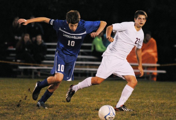 Bangor's Cole Sherbak (right) and Lawrence's Nicholas Chamberlain chase down a loose ball during first half-action on Tuesday night. Bangor won 5-0.