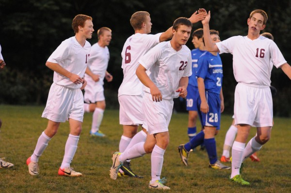 Bangor's boys soccer team celebrates one of its five goals against Lawrence on Tuesday at Bangor.