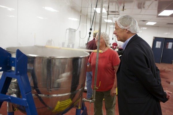 From left, Jan Anderson gives Rep. Mike Michaud a tour of Coastal Farms and Food Processing Friday afternoon in Belfast. As regulations tighten, incubators like Coastal Farms could become more important in Maine's small-farm economy.
