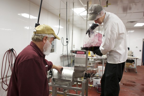 From left, Peter Collin, a blueberry farmer, and Scott Thomas, production manager at Coastal Foods, make blueberry puree Friday afternoon at Coastal Farms and Food Processing in Belfast. As regulations tighten, incubators like Coastal Farms could become more important in Maine's small-farm economy.