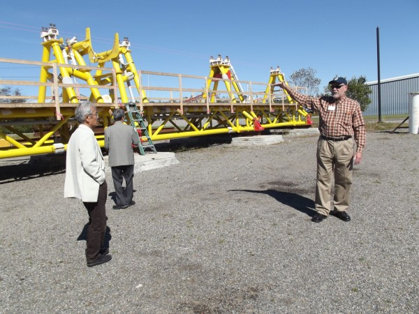 Bob Lewis, director of operations and planning and chief safety officer at Ocean Renewable Power Co.'s Eastport office, shows off components of the company's tidal generating equipment to visitors from Japan on Wednesday.