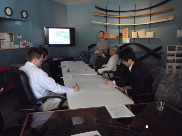Glen Marquis, manager of project development for Ocean Renewable Power Co., briefs members of a Japanese delegation at the company's Eastport office on Wednesday.