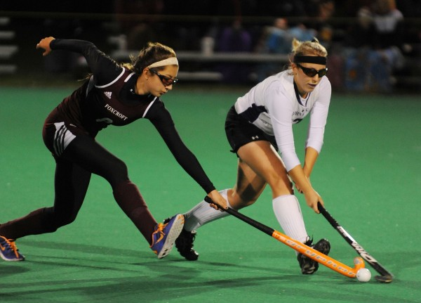 John Bapst's Samantha Ballesteros (right) and Foxcroft Academy's Fern Morrison battle for control of the ball during second-half action at the University of Maine in Orono on Monday night.