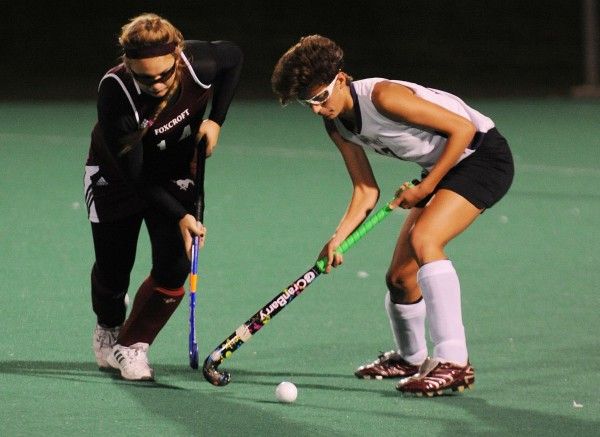 John Bapst's Lauren Tribuuzio (right) and Foxcroft Academy's Mackenzie Coiley battle for control of the ball during second-half action at the University of Maine in Orono on Monday night.