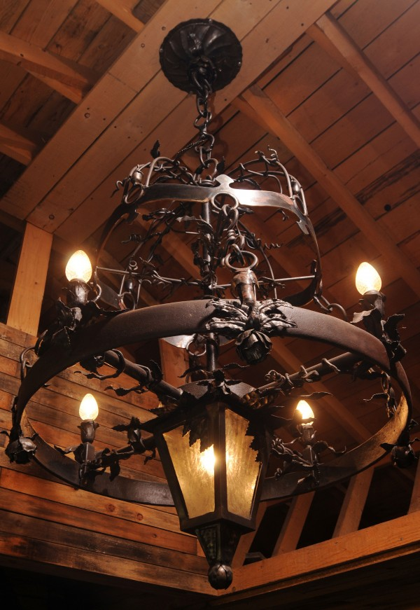 A custom hand-crafted chandelier which includes intricate roses, leaves and etched glass made by Jerry Gallant to hang over his anvil at his blacksmith shop in Levant. Gallant says he has over 500 hours into the piece.