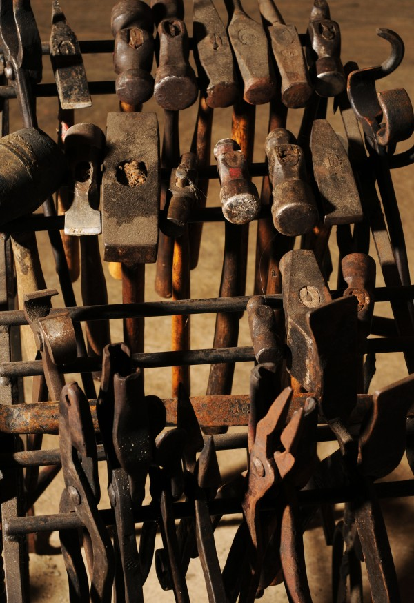 A rack of tools used by blacksmith Jerry Gallant hang next to his forge his shop at his home in Levant.