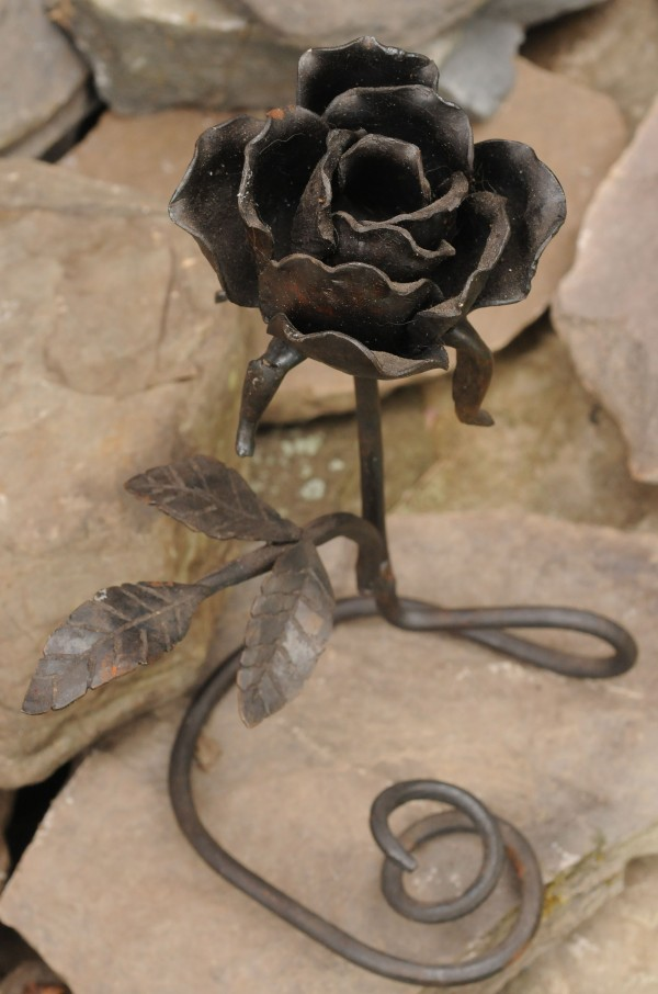 A rose made from hammered steel by blacksmith Jerry Gallant was a present to his wife, just one of many items Gallant made while honing his blacksmith hobby.