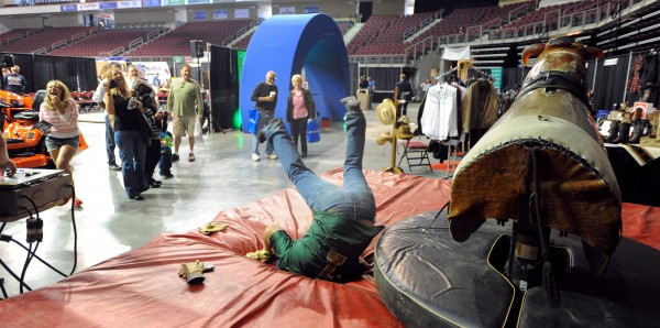 Tom Demers of Bangor takes a tumble off the mechanical bull during the first BDN Man Expo Saturday at the Cross Insurance Center.