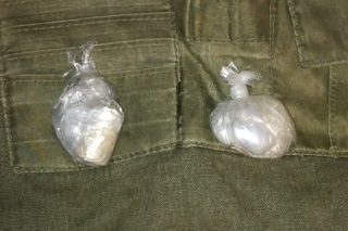 Police confiscated two bags they say contained heroin and the designer drug &quotmolly.&quot