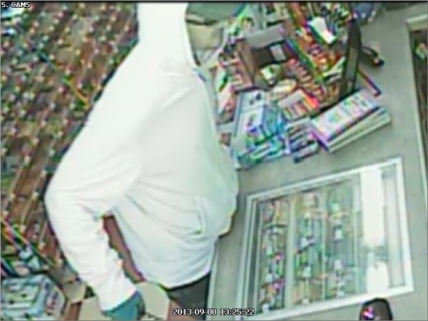 Video surveillance footage from the Checkout convenience store in Glenburn shows a man who walked into the store armed with a hunting knife Sunday afternoon and demanded money. Police are searching for the suspect in the robbery.