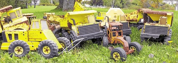 Joe Plummer of Searsport is coordinating the Tonka Truck Restoration Project for children who have Tonka trucks, such as these well-loved and played with vehicles, in need of restoration.