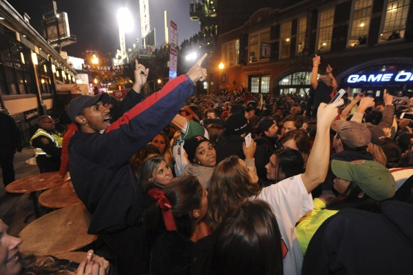 Boston Red Sox fans react to their team winning the MLB baseball's World Series after beating  St. Louis Cardinals in Game 6, at Landsdown Street near Fenway Park in Boston October 30, 2013.