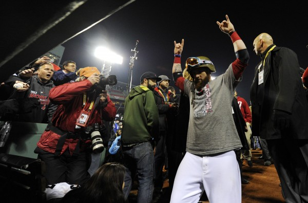 Boston Red Sox left fielder Jonny Gomes heads to the clubhouse after game six of the MLB baseball World Series against the St. Louis Cardinals at Fenway Park. The Red Sox won 6-1 to win the series four games to two.