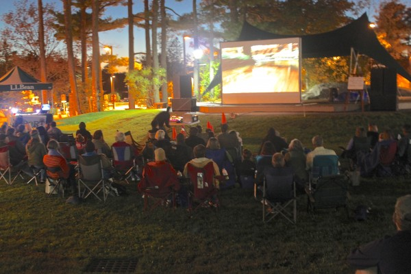 People relax in camp chairs as they watch a variety of outdoor films of the Great Maine Outdoor Film Festival on Sept. 28 in L.L.Bean's Discovery Park in Freeport.