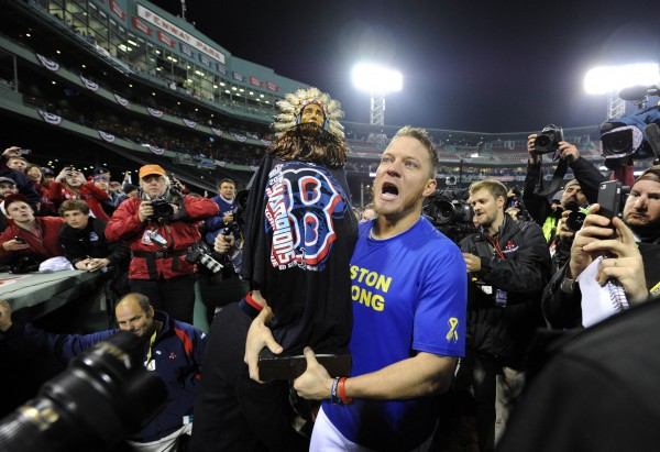 Boston Red Sox starting pitcher Jake Peavy celebrates on the field after game six of the MLB baseball World Series against the St. Louis Cardinals at Fenway Park. The Red Sox won 6-1 to win the series four games to two.