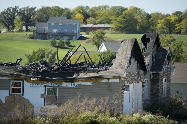 The charred remains of Melinda Coleman's home are shown on October 9, 2013, in Maryville, Missouri.