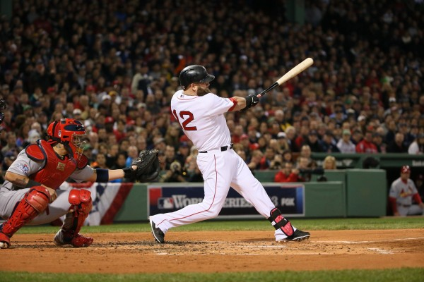 Mike Napoli of the Boston Red Sox drives in three runs with a double in the first inning against the St. Louis Cardinals in Game 1 of the World Series at Fenway Park in Boston, Massachusetts, on Wednesday, October 23, 2013.