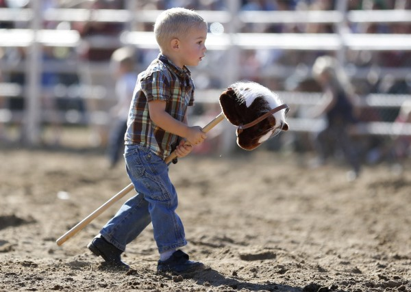 A youngster competes in a race during the rodeo at the Cumberland County Fair, Saturday, Sept 28, 2013.