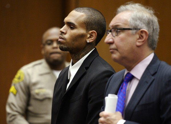 Singer Chris Brown (C) and his attorney Mark Geragos (R) are pictured during a probation progress hearing in Los Angeles Superior Court in Los Angeles in this August 16, 2013 file photo.  Brown has been arrested in Washington, DC on assault charges according to local news reports.