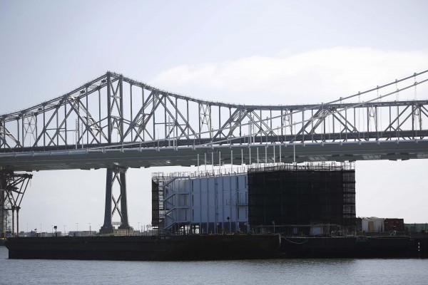 A barge built with four levels of shipping containers is seen at Pier 1 at Treasure Island in San Francisco, Calif., Oct. 28, 2013.