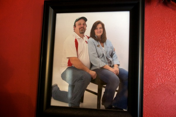 A portrait of Phils and Gail Gary hangs on the living room wall of their home in Brunswick Tuesday. Two weeks ago, Phil died suddenly.
