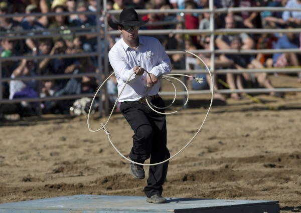Austin Stewart of Cumberland, Maine, performs tricks with a rope while entertaining at the Cumberland County Fair Rodeo, Saturday, Sept 28, 2013.