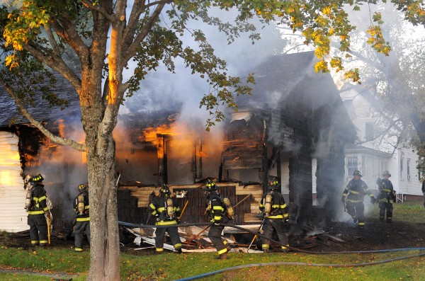 Firefighters hit hot spots on a structure that caught fire on Buck Street in Bangor on Tuesday evening.