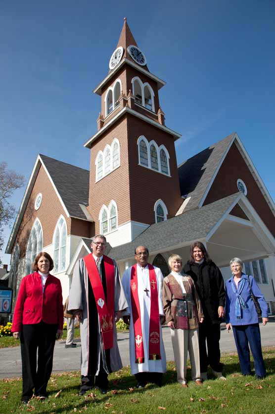 The Rev. Dr. Pat MacHugh,Northern District superintendent(from left); the Rev. Dr. Thomas Bentum, current pastor; Sudarshana Devadhar, New England Conference bishop; the Rev. Lynne Josselyn, former pastor; the Rev. Phil Polhemus, as Methodist founder Jesse Lee; and Maryanne Harlan, wife of deceased Pastor Dan Harlan, stand in front of the Gray Memorial United Methodist Church on Oct. 6. The group gathered to honor the 100th anniversary of the church's location on the corner of Sweden and Prospect streets in Caribou.