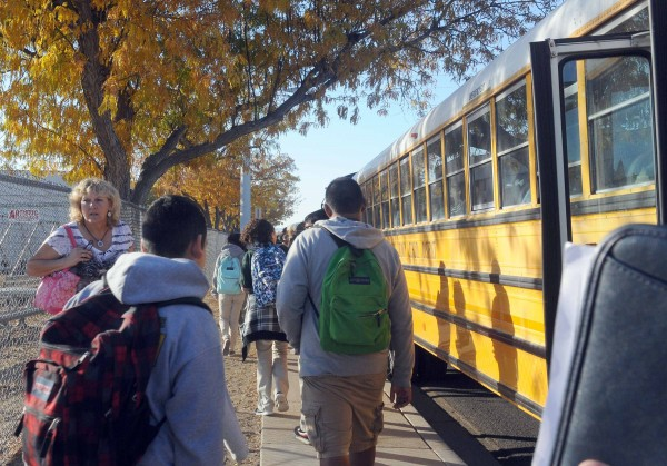 Students from Sparks Middle School go to waiting buses to be transported to Sparks High School after the school shooting to be reunited with their parents in Sparks, Nevada, October 21, 2013. A staff member was killed and two students were wounded on Monday when a student opened fire at a middle school in the northern Nevada city of Sparks before taking his own life, a county official said.