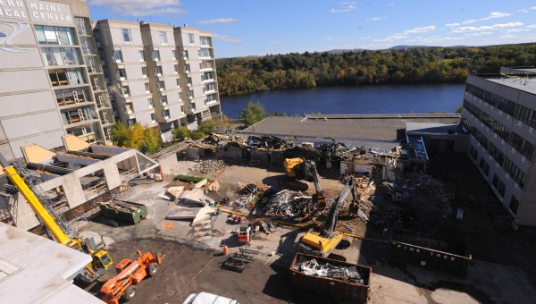 The demolition of a single story building at Eastern Maine Medical Center in Bangor is under way Turesday afternoon. The work is part of the $250 million expansion and modernization project at the hospital.