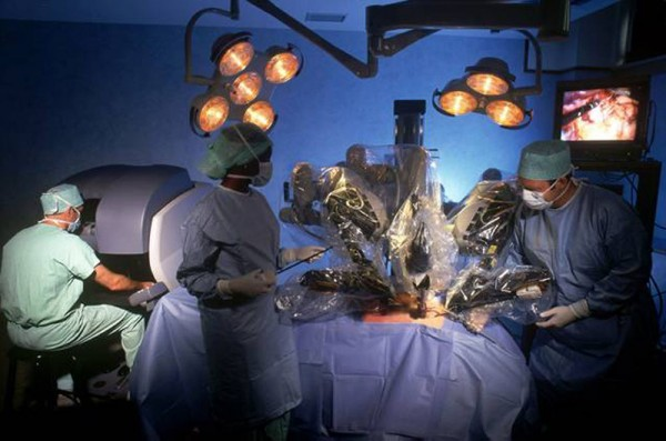 Robotic surgeries are on the rise, fueled by aggressive marketing that has hyped the procedure, often claimed fewer complications without proof, and sometimes ignored contradictory studies finding no advantage. Surgeons practice using a robotic surgical system in this handout photo from its maker, Intuitive Surgical, Inc