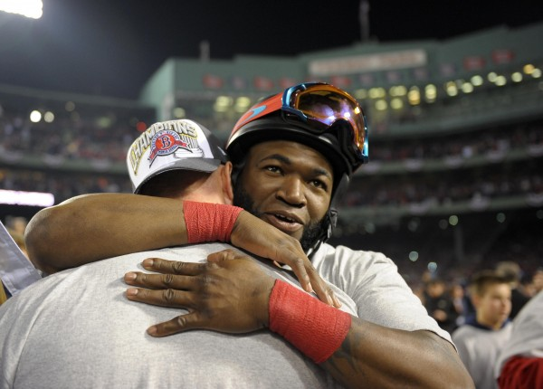 Boston Red Sox designated hitter David Ortiz (facing forward) celebrates with teammates on the field after game six of the MLB baseball World Series against the St. Louis Cardinals at Fenway Park. The Red Sox won 6-1 to win the series four games to two.