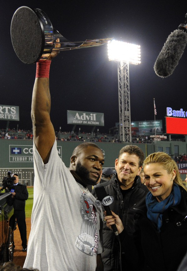 Boston Red Sox designated hitter David Ortiz (left) hoists the series MVP trophy while being interviewed by FOX reporter Erin Andrews after game six of the MLB baseball World Series against the St. Louis Cardinals at Fenway Park.