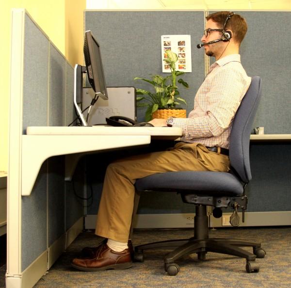 Adam Levesque of MEMIC's claim department demonstrates proper office ergonomic fit.