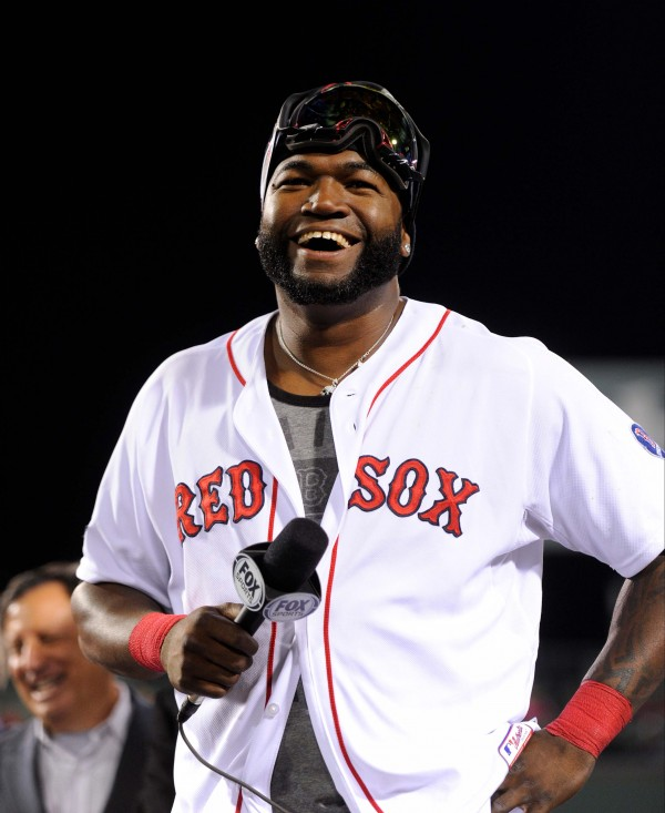 Boston Red Sox designated hitter David Ortiz speaks to the crowd after defeating the Detroit Tigers in game six of the American League Championship Series playoff baseball game at Fenway Park.