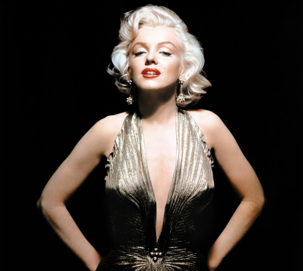 "In this undated publicity photo, Marilyn Monroe is shown wearing a knife-pleated gold lamé gown made from ""one complete circle of fabric."" She wore this dress in &quotGentlemen Prefer Blondes.&quot"