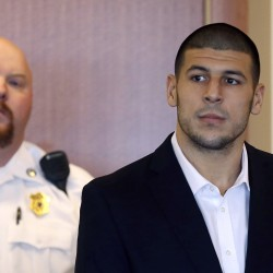 Police in murder probe study items seized from New England Patriots player Aaron Hernandez's home