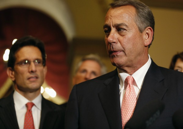 Speaker of the House John Boehner turns away after speaking to the news media with U.S. House Majority Leader Eric Cantor (R-VA) (L) at his side at 1:00 am in the morning after the House of Representatives voted to send their funding bill with delays to the &quotObamacare&quot health care act into a conference with the Senate, prompting a shutdown of portions of the U.S. government in Washington, October 1, 2013. The U.S. government began a partial shutdown on Tuesday for the first time in 17 years, potentially putting up to 1 million workers on unpaid leave, closing national parks and stalling medical research projects.