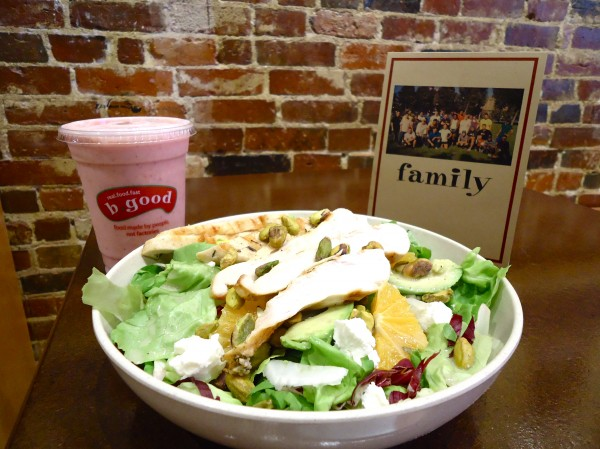 Meals like the avocado and orange salad with chicken are fresh and ready within minutes at b.good. The strawberry shake is made with Gifford's Ice Cream from Skowhegan. Customers are called family members and photos of local farms such as Spiller in Wells grace the walls.