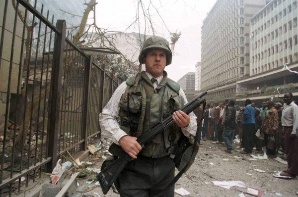 A U.S. embassy official secures the area around the embassy building after a powerful bomb blast in Nairobi in this file photo taken Aug. 7, 1998.  Senior al-Qaida figure Anas al-Liby, indicted by the United States for his alleged role in the 1998 bombings of U.S. embassies in East Africa, was captured in Libya by a U.S. team and is in American custody, U.S. officials said Saturday.