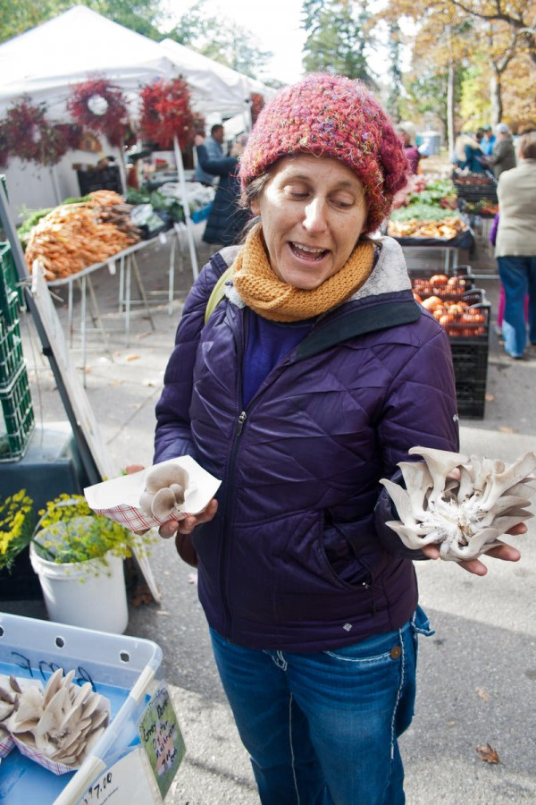 Lisa Silverman, a cooking teacher who founded Five Seasons Cooking School, picks up a pound of the mushrooms at the Portland Farmers Market on Saturday.