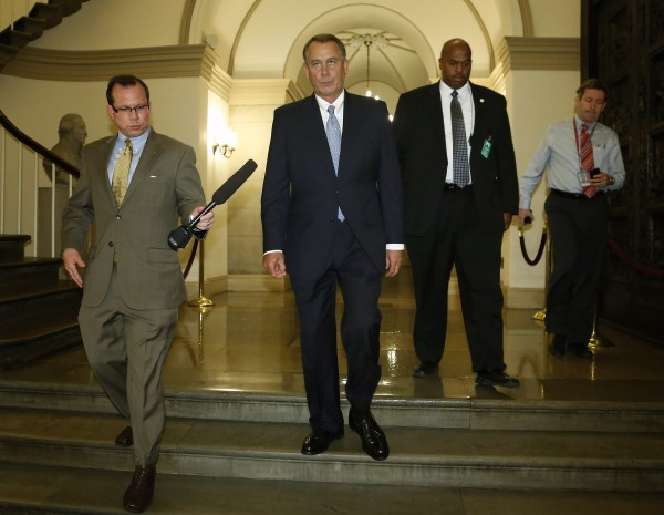 U.S. House Speaker John Boehner (R-OH) (2nd L) departs for a meeting at the White House with President Barack Obama, from the U.S. Capitol in Washington, October 2, 2013. The fight between Democrats and the Republicans over the government's borrowing power is rapidly merging with the standoff over every day funding, which has forced the first government shutdown in 17 years and forced hundreds of thousands of federal employees to take unpaid leave.