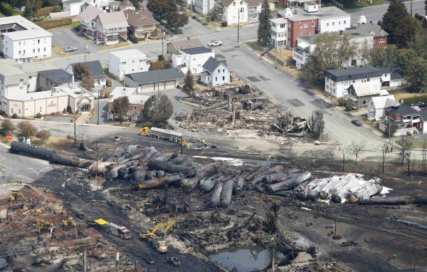 The remains of a burnt train are seen in Lac-Megantic, Quebec, in this July 8, 2013 file photo.