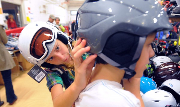 Clarie Tobin, 15, of Bangor (left) checks if a helmet is the right fit for her brother William, 11, as they were looking for new ski equipment during the Penobscot Valley Ski Club's annual ski sale at the Parks and Recreation building in Bangor in this file photo.