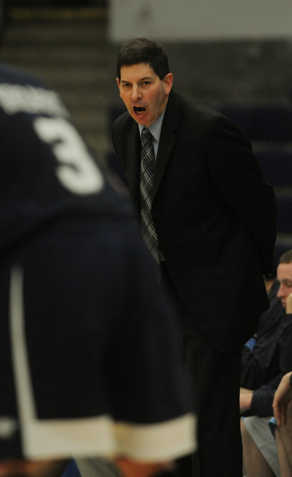 UMaine men's basketball head coach Ted Woodward hollers to his players during first half action against UNH at Orono on Wednesday, Jan. 30, 2013.