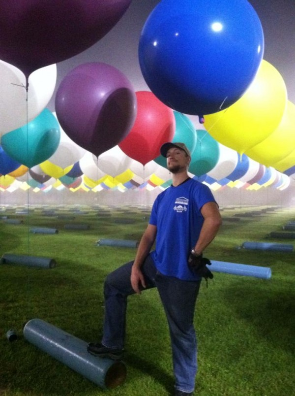 Kyle Washington of Presque Isle was among the scores of volunteers inflating balloons Wednesday night and Thursday morning for Jonathan Trappe's transatlantic balloon flight taking off from Caribou.
