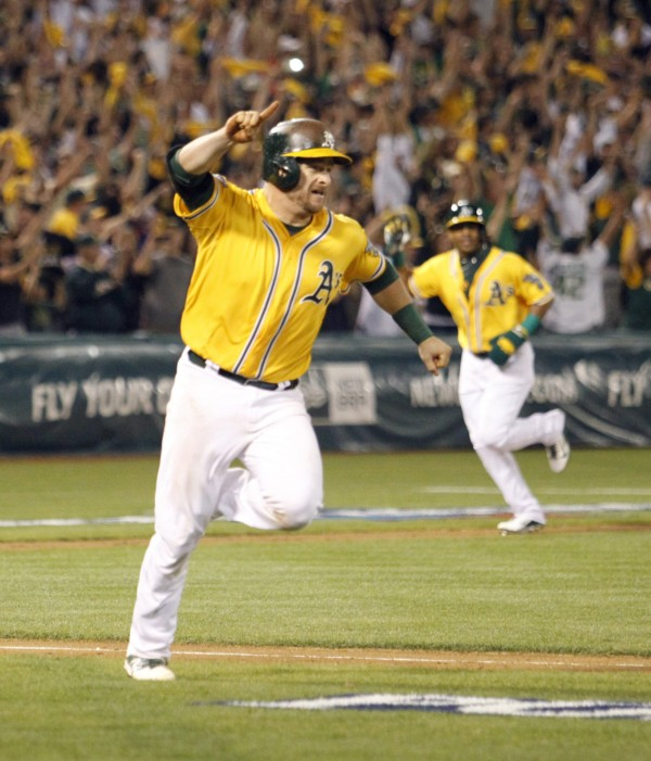 The Oakland Athletics' Stephen Vogt exults after hitting a bases-loaded, RBI single in the ninth inning against the Detroit Tigers in Game 2 of an American League Division Series at O.co Coliseum in Oakland Saturday night. The A's won, 1-0, to tie the series.